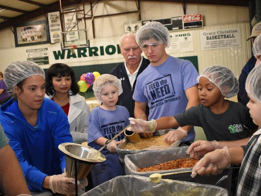 Grace Christian School students were busy Friday, Dec. 7, 2018 packing about 10,000 dried meals that will be sent to Haiti and for use at the Manna House, a local non-profit that feeds those in need.  The project called, Feed the Need, started in November and concluded Friday.  Students at the school raised over $80,000 in a month.  Pre-Kindergarten and Kindergarten students were paired with older students to help pack meals. Sponsors for the event were Christus St. Frances Cabrini Hospital, Southern Air Heating and Cooling, Tarver Land Development, Rapides Regional Medical Center, Red River Bank, Rhodes Pediatrics, the Urology Clinic of Central Louisiana, Pill Box Pharmacy and the Halliburton Auto Clinic.