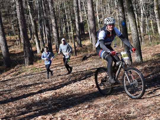 Hundreds of cyclists and runners participate in Wild Azalea Trail Challenge at Kisatchie National Forest. The Wild Azalea Trail is the longest continuous trail in Louisiana at 26 miles.