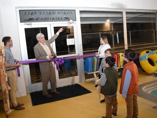 Alexandria Senior High School swim coach Wally Fall said he had been admiring the glass panel above the doorway proclaiming it the Coach Wally Fall Nanatorium. The swimming pool at ASH was renamed the Coach Wally Fall Nanatorium Monday, Jan. 7, 2019 after ASH and COAST swim coach Wally Fall. Fall has coached for over 40 seasons, winning eight state swimming titles with seven runner-up finishes. Fall has also served in high school administration, serving as principal at Scott M. Brame Middle School for 18 years. Fall was also inducted to the Louisiana Sports Hall of Fame last year. In front are Fall's grandsons Baylor Fall, 7; Jackson Parten, 6; and Graham Parten, 5.