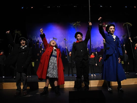 """Maggie Bell (far right) portrays the lead role of Mary Poppins in Our Lady of Prompt Succor School's """"Mary Poppins, Jr.."""" Sutton Blakesley (second from right) is the chimney sweep Bert. Evie LaFleur (second from left) and Andrew Babin (far left) are the Banks childrenJane and Michael."""
