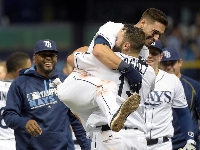 April 30: Rays' Curt Casali is mobbed by teammate Kevin