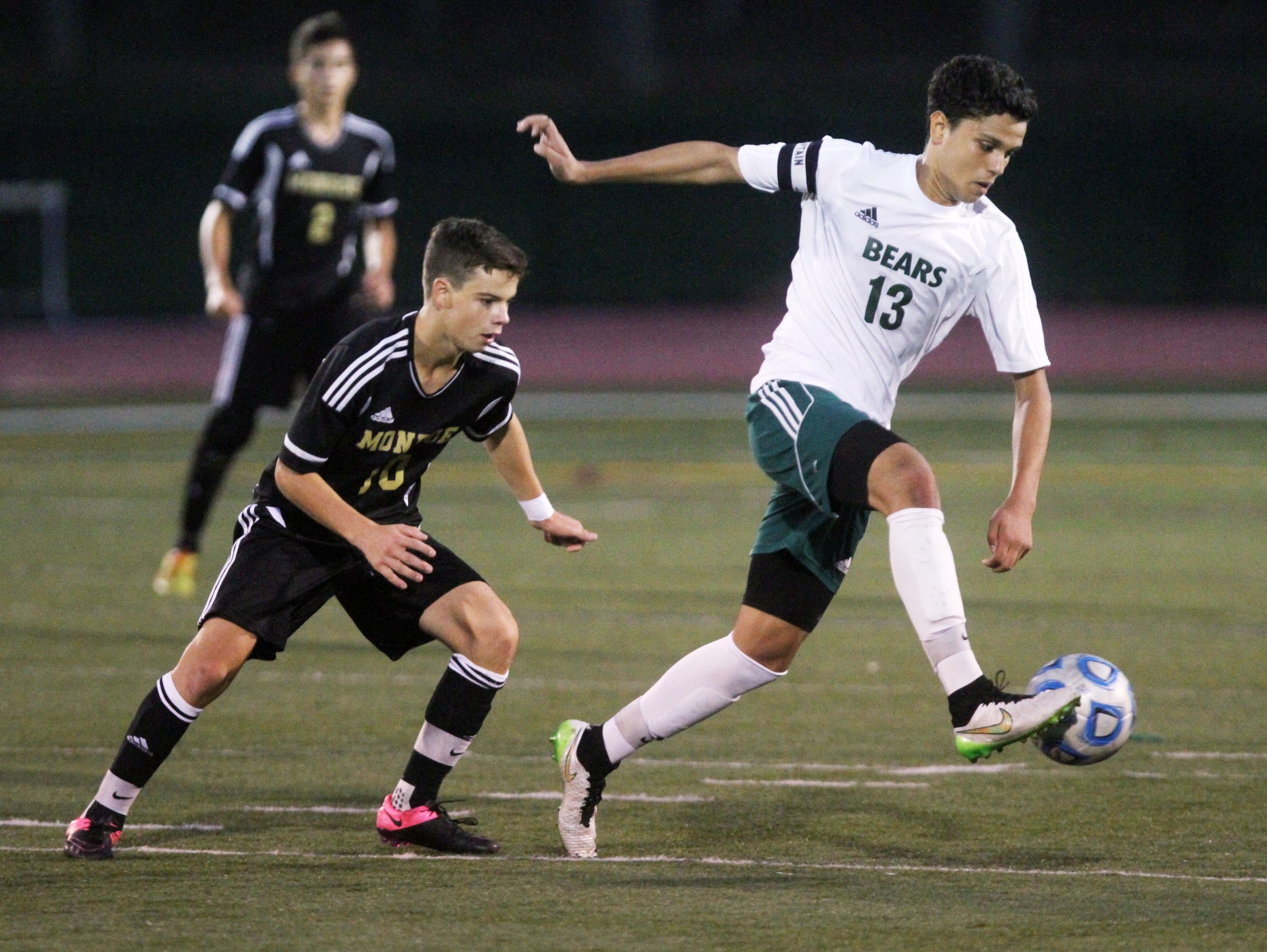 East Brunswick's Mohamed Fquihi kicks in front of Monroe's Alex Fernandez, Thursday, October 8, 2015, in East Brunswick, NJ.