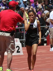 Navajo Prep's Sarah Chacon reacts to her state championship win in the 800 meters during Saturday's state track and field championship meet in Albuquerque.