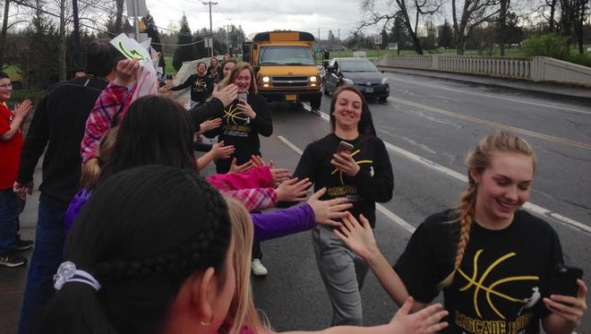 Students at Turner Elementary School give the Cascade High School girls basketball team a send-off to state.