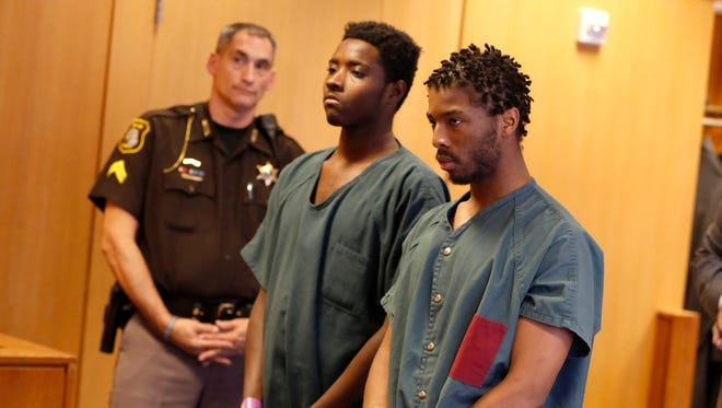 Defendants Jujaun Williams, left, and Charles Brown listen to Judge Langston Lewis at the Frank Murphy Hall of Justice in Detroit on Wed., Dec. 13, 2017. The two were alleged to have robbed and shot a transgendered woman, Sharita Maxwell, in November.