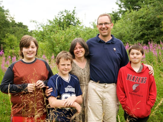 The Thies family spend some time together in a nature reserve behind their new home.