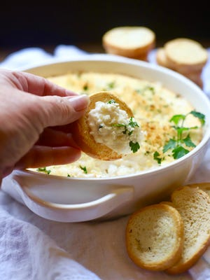 Hot and Cheesy Baked Shrimp Scampi Dip comes together quickly and can be made up to 24 hours ahead.