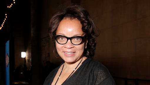 """This file photo shows costume designer Ruth E. Carter attending the AFI FEST 2014 """"Selma"""" screening held at the Egyptian Theatre, in Los Angeles. Carter designed the costumes for the film, which is nominated for an Oscar for best picture. Carter, a two-time Oscar nominee, will be honored Thursday with the Visionary Award at the Black Women in Hollywood Luncheon."""