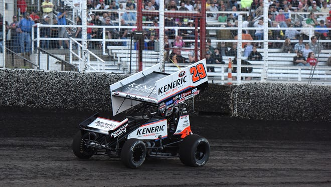 Kerry Madsen, #29, takes part in the sprint car races during Badlands Motor Speedway grand opening in Brandon, S.D., Saturday, May 21, 2016.