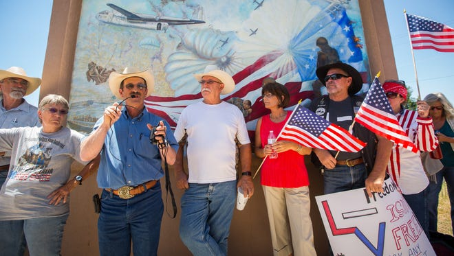 Gary Stone, left, speaks at the Stand By Me for Liberty group rally at Alameda Park in Alamogordo, July 9, 2016. The rally was organized, the group said, to raise awareness about the violation of rancher's private property and water rights by the New Mexico Bureau of Land Management and the U.S. Forest Service.