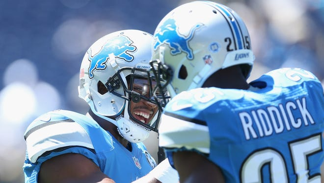 Running backs Ameer Abdullah, left, and Theo Riddick of the Detroit Lions warm up before a game against the San Diego Chargers on Sept. 13, 2015, in San Diego.