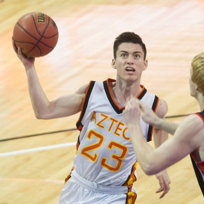Corona del Sol's Alex Barcello drives to the hoop against