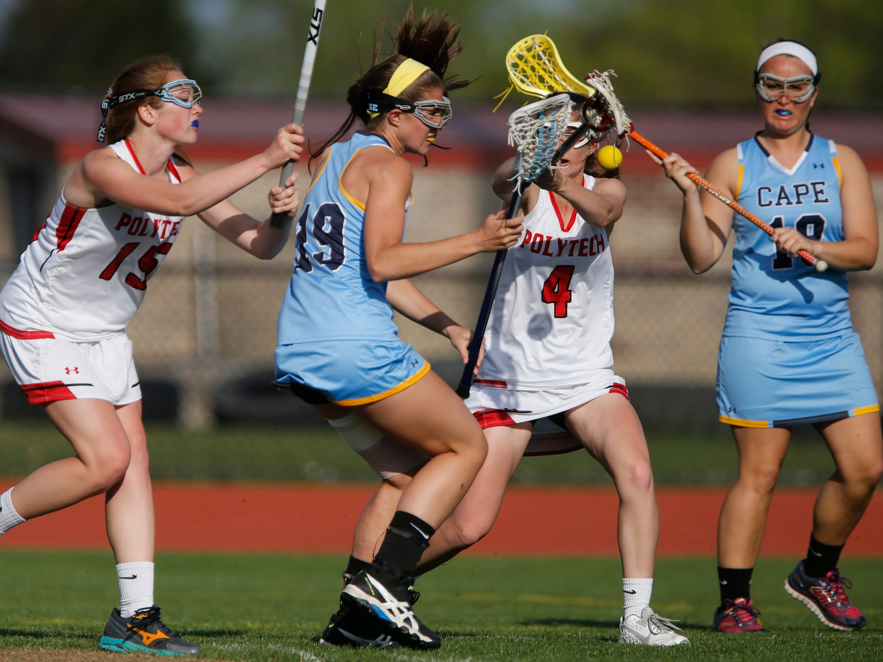Cape Henlopen's Alison Palmer (19) tries to get through Polytech's Grace Stang (left) and Kaitlin Bergold as Cape's Jordan Brown looks on at right, during Cape Henlopen's 19-9 win at Polytech Tuesday.