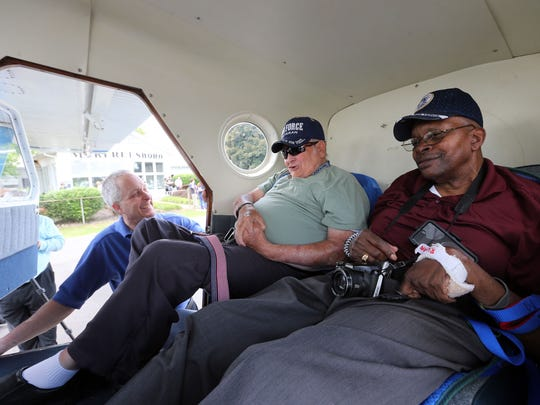 Veterans William Ellis, center, and Riley Howard, right, talk with MTSU professor Tony Johnston after landing in a de Havilland Canada DHC-2 Beaver for Middle Tennessee State University's Veterans Honor Flight Wednesday at Murfreesboro Municipal Airport.