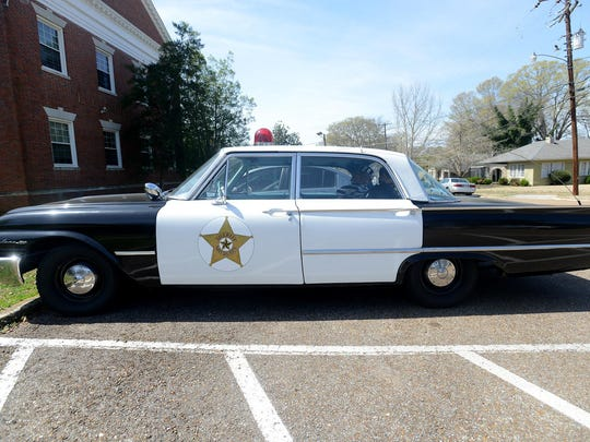 """A replica of the 1961 Ford Fairlane squad car used on """"The Andy Griffith Show"""" is on display at the University of Memphis Lambuth along with other items celebrating the history of the show."""