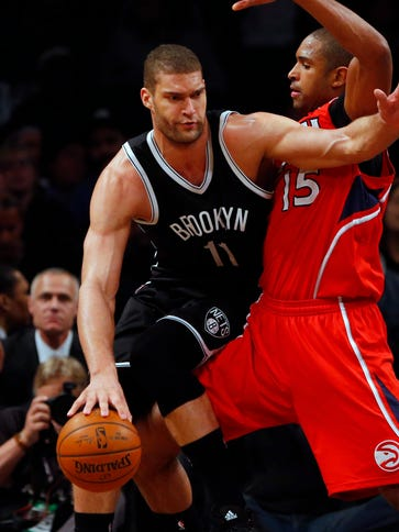 Brook Lopez (11) and the Nets beat the Hawks for the