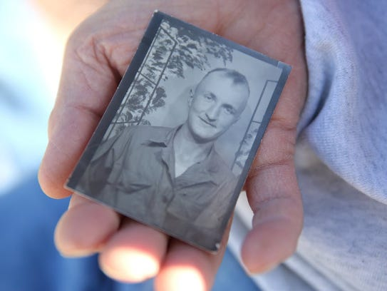 Lee Roy Wagner holds a photo of himself as an Army supply sergeant at Fort Dix, N.J., in the 1950s. Wagner died Sunday after suffering a massive stroke at Miller Park a week earlier where he was a parking lot cashier for more than two decades.