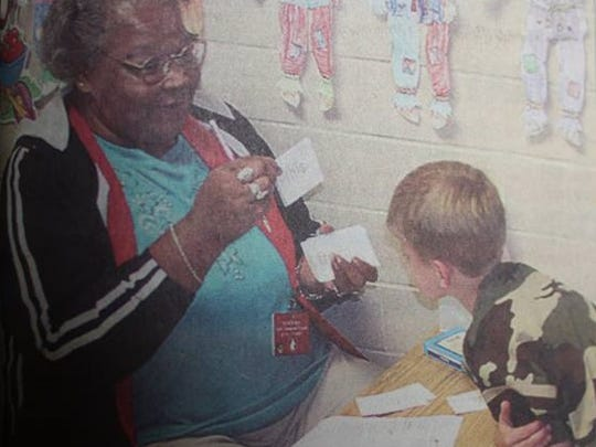 Foster Grandparent Ruth Stewart of Uniontown drills Morganfield Elementary student Will Holbrook in a reading lesson at the school on a Friday in October of 2004.