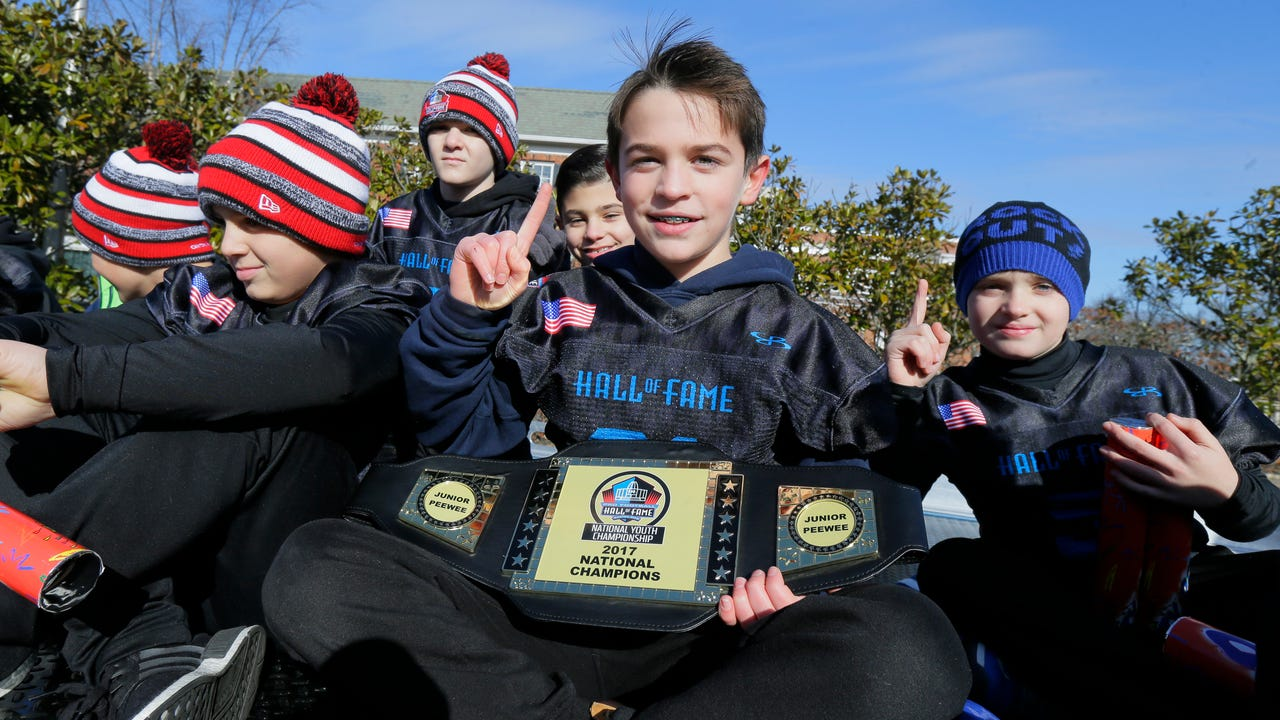 The Hanover Tigers youth football team was celebrated with a parade and an awards ceremony at the Hanover Civic Center. IPHONE VIDEO BY WILLIAM WESTHOVEN JAN. 15, 2018