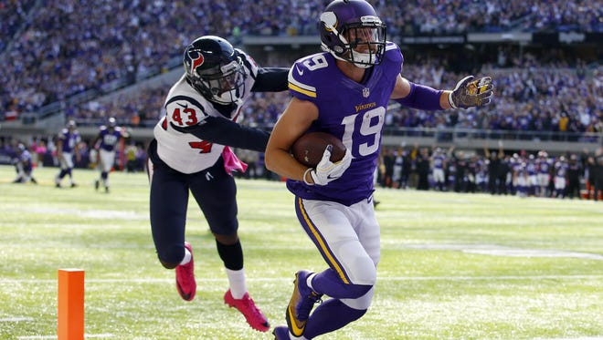 Minnesota Vikings wide receiver Adam Thielen (19) runs with the ball for a touchdown against the Houston Texans during a National Football League game Sunday, Oct. 9, 2016, in Minneapolis.