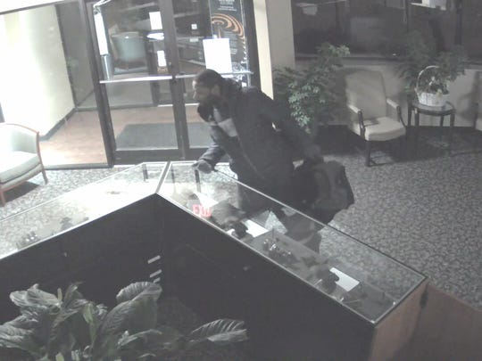 Security camera photo of the alleged robber.