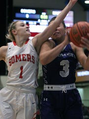 Somers' Jackie Penzo fights for a rebound with Masters.