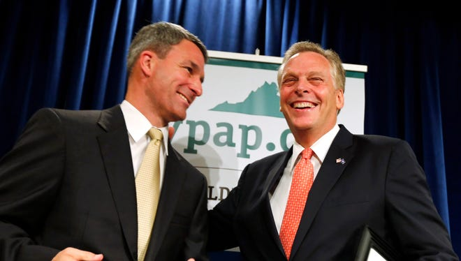 Republican Ken Cuccinelli, left, and Democrat Terry McAuliffe share a light moment at a Virginia governor's forum.