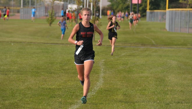 Port Huron's Rachel Bonner runs Friday in the James Cleverley Friday Night Lights Invitational at Anchor Bay. Bonner won the meet with a time of 18 minutes, 49 seconds.