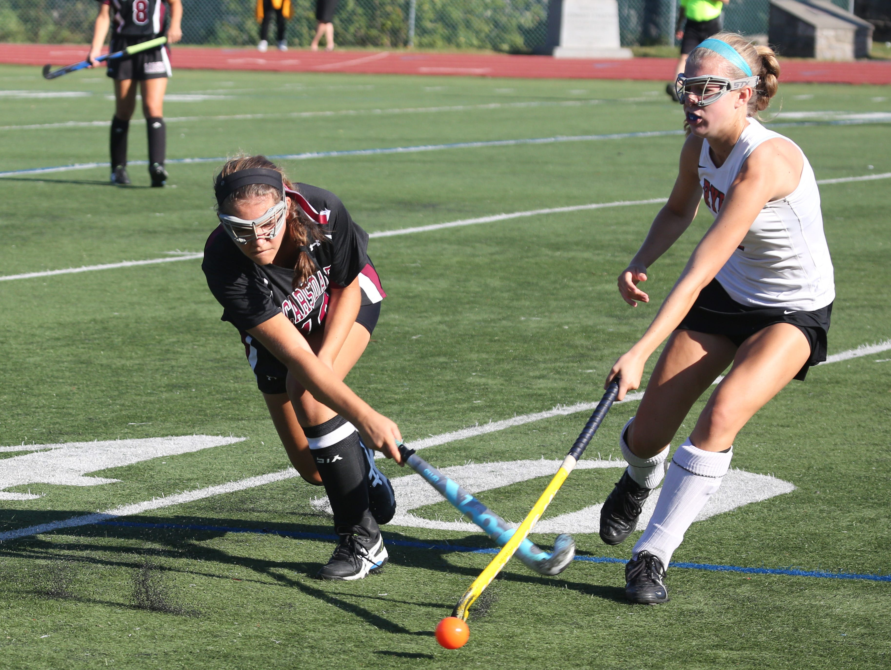 Scarsdale's Olivia Henkoff tries to get a shot past Rye's Ellie O'Callaghan during their field hockey game in Rye, Sept. 24, 2015. Rye beat Scarsdale, 3-1.