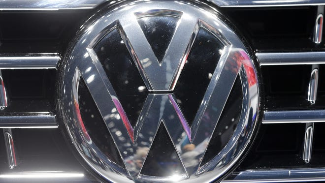 The VW Logo is photographed at a car at the Car Show in Frankfurt, Germany, Sept. 22, 2015. Volkswagen has admitted that it intentionally installed software programmed to switch engines to a cleaner mode during official emissions testing. The software then switches off again, enabling cars to drive more powerfully on the road while emitting as much as 40 times the legal pollution limit.