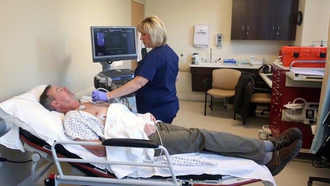 Ultrasonographer Loretta Lahey runs a test on Ed Butler, at Northern Dutchess Hospital in Rhinebeck in Dec. 2016.