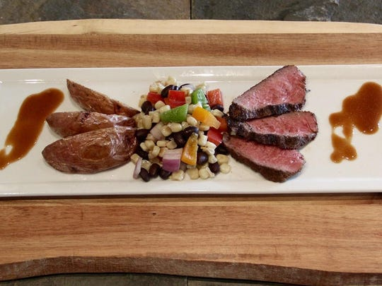 At the unveiling of the bonanza cut at the University of Nevada, chef Kaimi Coonrad of Cheese Board American Bistro & Catering Co. soaked the beef in a Southwest marinade and served it with potato wedges and with black bean and corn salsa.