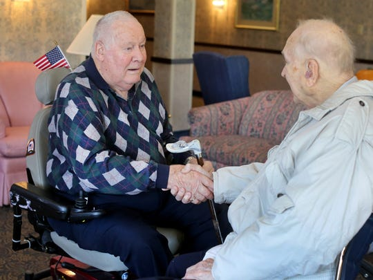 Paul Ruberg, left, and Roy Romes, both 90, meet for