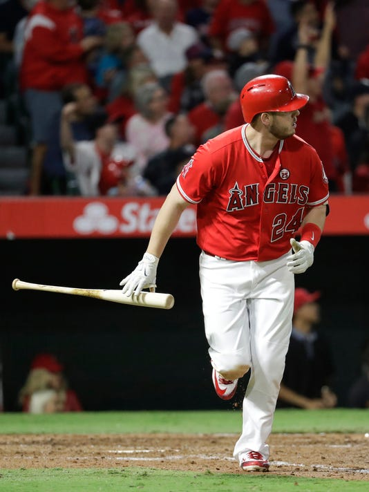 Los Angeles Angels' C.J. Cron watches his home run against the Cleveland Indians during the fifth inning of a baseball game against the Cleveland Indians in Anaheim, Calif., Wednesday, Sept. 20, 2017. (AP Photo/Chris Carlson)