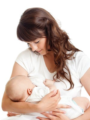 Young mother breast feeding her infant.