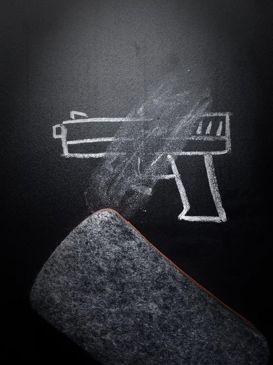 weapon draw erased on blackboard - no violence concept