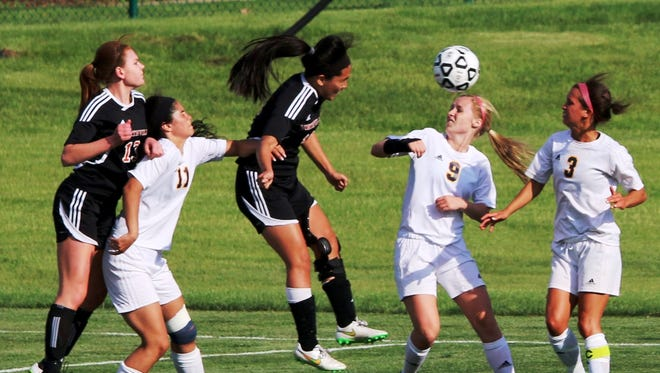 Northville's Sarah Park (middle) scores the game's first goal in Tuesday's shootout win over Hartland.