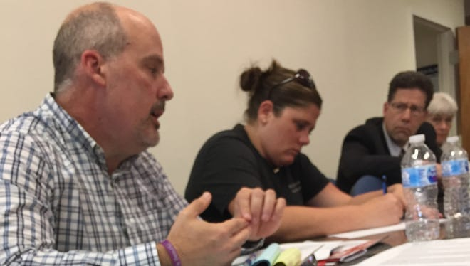 Brad Decamp, left, discusses grant funding with  fellow task force members Tuesday.