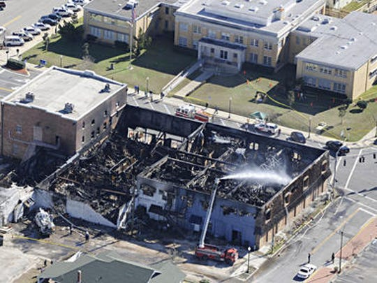 A fire in downtown Milton on Jan. 6, 2009, destroyed at least four office buildings and damaged the historic Imogene Theatre in the 6800 block of Caroline Street. The Santa Rosa County Courthouse is across the street from the fire scene.