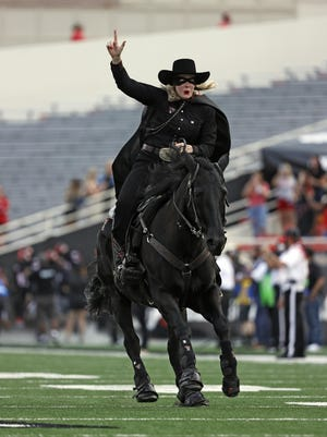 The Masked Rider leads the Texas Tech football team onto the field before the Red Raiders' season opener Saturday against Houston Baptist at Jones AT&T Stadium.