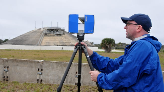 Scientists and researchers from the University of South Florida are supporting an Air Force preservation project by performing 3D scans of old launch facilities. Jeff DuVernay sets up the 3D scanner at Launch Complex 14 with the blockhouse in the background.
