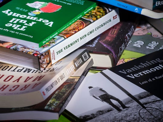A selection of books to consider giving over the holidays seen in Burlington on Thursday , November 30, 2017.