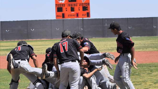 The Hanks Knights celebrate after beating El Paso High 3-1 in the third game of a Class 5A bidistrict series. Hanks will face Lubbock Cooper in the area round.