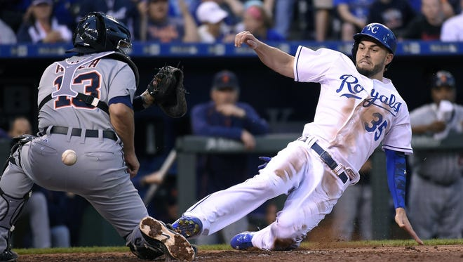 The Kansas City Royals' Eric Hosmer (35) scores as the ball pops loose from Detroit Tigers catcher Alex Avila (13) on a double by Kendrys Morales in the third inning at Kauffman Stadium in Kansas City, Mo., on Friday, May 1, 2015.
