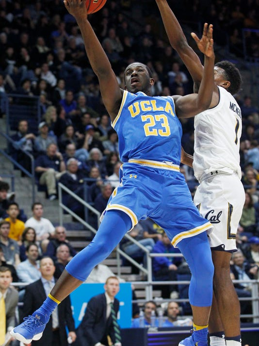 UCLA's Prince Ali goes up for a shot as California's Darius McNeill defends during the second half of an NCAA college basketball game Saturday, Jan. 6, 2018, in Berkeley, Calif. (AP Photo/George Nikitin)