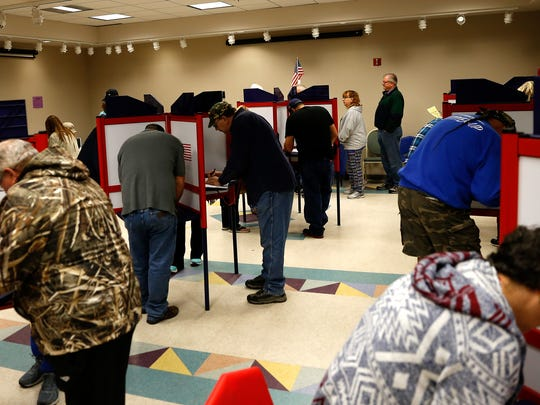 Voters fill out their ballots Friday at the Farmington Museum at Gateway Park.