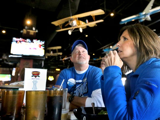 MTSU basketball ticket holders David and Jennifer McKnight watch the Lady Raiders during the team's first round game of the NCAA Tournament, on television, at Sam's Sports Grill, Saturday, March 19, 2016. Despite a strong start, MTSU lost to Florida State 72-55.