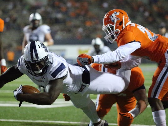 Old Dominion tight end Melvin Vaughn, 1, falls into