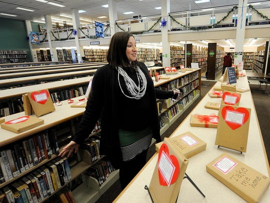 """Adult Services Librarian Jenci Spradlin talks to The Jackson Sun about their """"Try a Blind Date with a Book"""" program at the Jackson-Madison County Library in Downtown Jackson on Thursday, Feb. 9, 2017."""