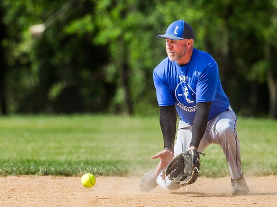 Jack Evans, a member of the James T. Vaughn Correctional Center softball team, fields a grounder during the Dedication and Valor Softball Tournament, played in honor of Lt. Steven Floyd and Cpl. Stephen Ballard at the Delcastle Softball Complex in Milltown on Sunday morning.